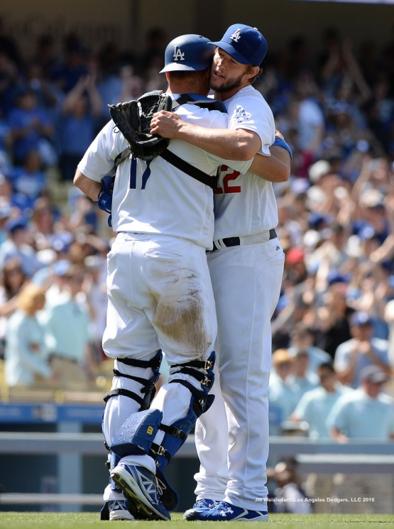 A.J. Ellis celebrates with Clayton Kershaw after the Dodgers get the win against the San Diego Padres.  The Dodgers beat the Padres 1-0. Jill Weisleder/Dodgers
