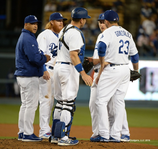 Dodger skipper Dave Roberts has a meeting on the mound. Jill Weisleder/Dodgers