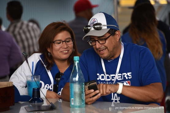 Great Los Angeles Dodgers fans play with their device prior to game against the Los Angeles Angels of Anaheim Monday, May 16, 2016 at Dodger Stadium in Los Angeles, California.  Jon SooHoo/©Los Angeles Dodgers,LLC 2016
