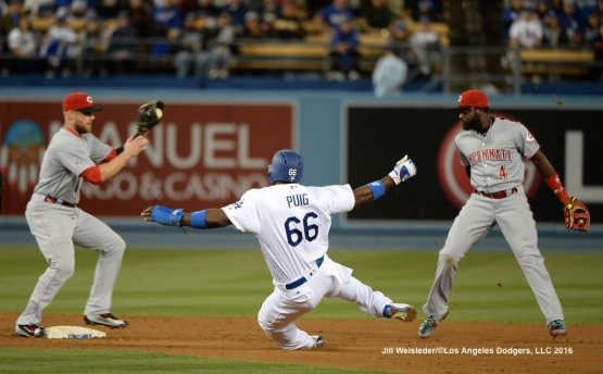 Zack Cozart of the Cincinnati Reds makes the catch to get out Yasiel Puig at second base. Jill Weisleder/Dodgers