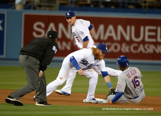 Justin Turner applies the tag to Alejandro DeAza. Jill Weisleder/Dodgers