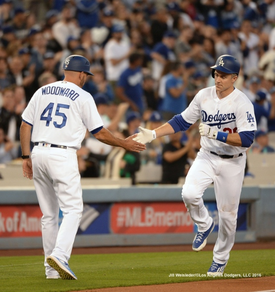 Third base coach Chris Woodward congratulates Chase Utley as he rounds the bases after getting a home run. Jill Weisleder/Dodgers