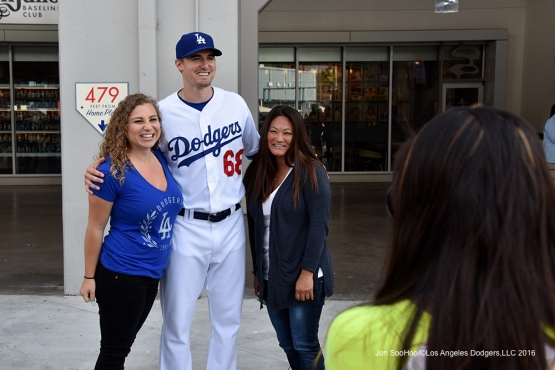 Ross Stripling poses with fans prior to game against the Los Angeles Angels of Anaheim Monday, May 16, 2016 at Dodger Stadium in Los Angeles, California.  Jon SooHoo/©Los Angeles Dodgers,LLC 2016