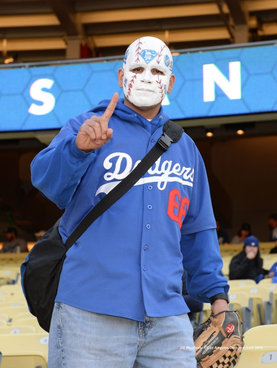 A Dodgers fan poses for a photo and shows his support for the team. Jill Weisleder/Dodgers