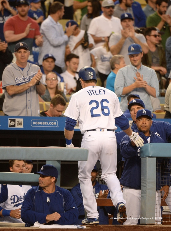 Dodger fans cheer on as Chase Utley is congratulated by Dave Roberts as he goes into the dugout. Jill Weisleder/Dodgers