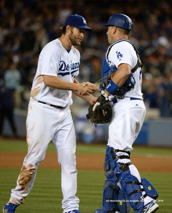 Clayton Kershaw shakes hands with A.J. Ellis as the Dodgers take the 1-0 win against the Cincinnati Reds. Jill Weisleder/Dodgers