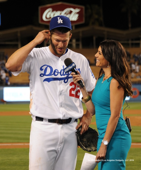 Dodger SportsNet LA team member Alanna Rizzo interviews pitcher Clayton Kershaw after the game.  Kershaw allowed only two hits during the game against the Cincinnati Reds. Jill Weisleder/Dodgers