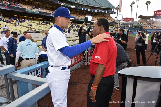 Trayce Thompson talks to Rod Carew prior to game against the Los Angeles Angels of Anaheim Monday, May 16, 2016 at Dodger Stadium in Los Angeles, California.  Jon SooHoo/©Los Angeles Dodgers,LLC 2016