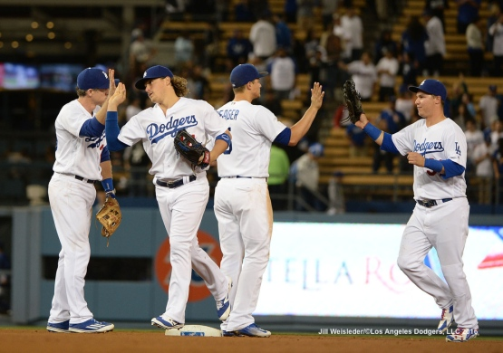 The Dodgers celebrate a 5-0 win to split the series agains the New York Mets. Jill Weisleder/Dodgers