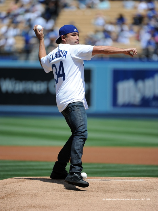 Olympic gold medalist and boxing champ Oscar De La Hoya throws out the ceremonial first pitch prior to the start of the game. Jill Weisleder/Dodgers