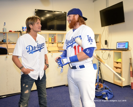 Country music star Keith Urban speaks with Justin Turner prior to the start of the game. Jill Weisleder/Dodgers