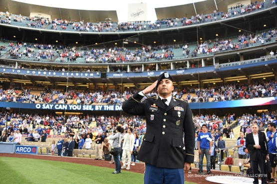 Los Angeles Dodgers Military Hero of the game Jesus Martinez salutes during the anthem prior to game against the Los Angeles Angels of Anaheim Monday, May 16, 2016 at Dodger Stadium in Los Angeles, California.  Jon SooHoo/©Los Angeles Dodgers,LLC 2016
