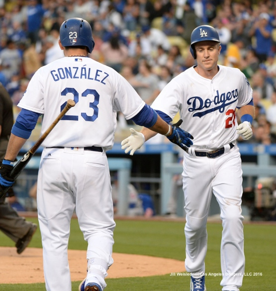 Adrian Gonzalez high-fives Chase Utley after coming in to score. Jill Weisleder/Dodgers