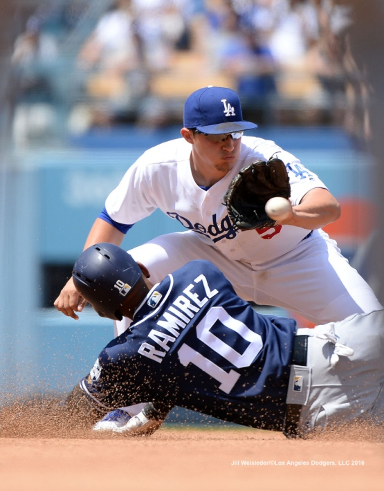 Corey Seager makes the tag on Alexei Ramirez at second base. Jill Weisleder/Dodgers