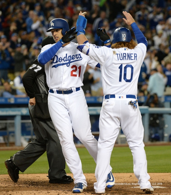 Justin Turner celebrates with Trayce Thompson at home plate after getting a two-run home run. Jill Weisleder/Dodgers