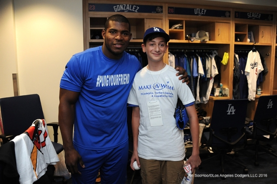Los Angeles Dodgers Yasiel Puig poses with Landon Byskal of Newark, Delaware prior to game against the Colorado Rockies Tuesday, June 7, 2016 at Dodger Stadium in Los Angeles,California. Photo by Jon SooHoo/© Los Angeles Dodgers,LLC 2016