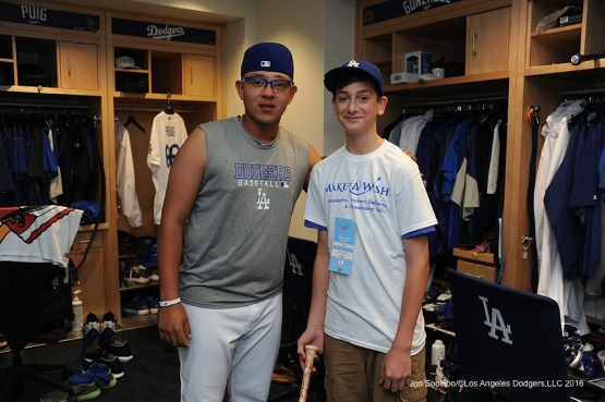 Los Angeles Dodgers Julio Urias poses with Landon Byskal of Newark, Delaware prior to game against the Colorado Rockies Tuesday, June 7, 2016 at Dodger Stadium in Los Angeles,California. Photo by Jon SooHoo/© Los Angeles Dodgers,LLC 2016