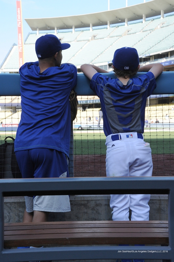Los Angeles Dodgers Cole Roberts and Luke Bard watch batting practice against the Colorado Rockies Tuesday, June 7, 2016 at Dodger Stadium in Los Angeles,California. Photo by Jon SooHoo/© Los Angeles Dodgers,LLC 2016