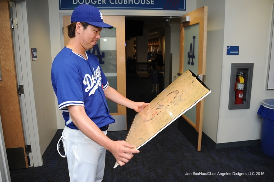 Kenta Maeda holds a message board sent from the children of Tadaoka, Osaka which is Maeda's home town. Tuesday, June 7, 2016 at Dodger Stadium in Los Angeles,California. Photo by Jon SooHoo/© Los Angeles Dodgers,LLC 2016