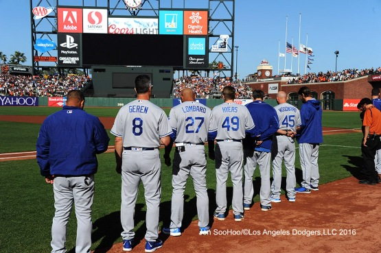 Los Angeles Dodgers stand for moment of silence for Orlando tragedy prior to game against the San Francisco Giants Sunday, June 12, 2016 at AT&T Park in San Francisco, California. Photo by Jon SooHoo/© Los Angeles Dodgers,LLC 2016