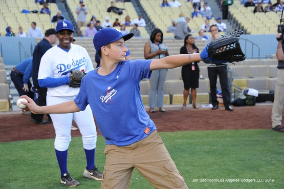 Landon Byskal of Newark, Delaware warms up to throw out the first pitch prior to game against the Colorado Rockies Tuesday, June 7, 2016 at Dodger Stadium in Los Angeles,California. Photo by Jon SooHoo/© Los Angeles Dodgers,LLC 2016