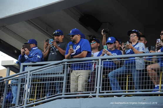 Great Los Angeles Dodger fans use their phones prior to game  against the Colorado Rockies Tuesday, June 7, 2016 at Dodger Stadium in Los Angeles,California. Photo by Jon SooHoo/© Los Angeles Dodgers,LLC 2016