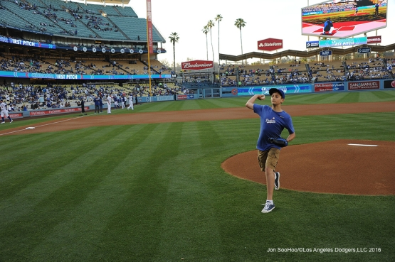 Landon Byskal of Newark, Delaware throws out the first pitch prior to game against the Colorado Rockies Tuesday, June 7, 2016 at Dodger Stadium in Los Angeles,California. Photo by Jon SooHoo/© Los Angeles Dodgers,LLC 2016