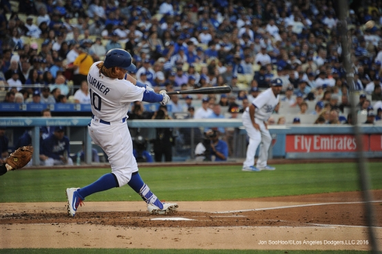 Los Angeles Dodgers Justin Turner hits a three run home run against the Colorado Rockies Tuesday, June 7, 2016 at Dodger Stadium in Los Angeles,California. Photo by Jon SooHoo/© Los Angeles Dodgers,LLC 2016