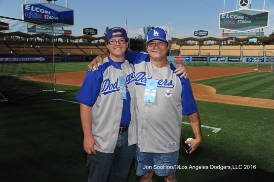 Great Los Angeles Dodger fans pose  during game against the Milwaukee Brewers Satuday, June 18, 2016 at Dodger Stadium. Photo by Jon SooHoo
