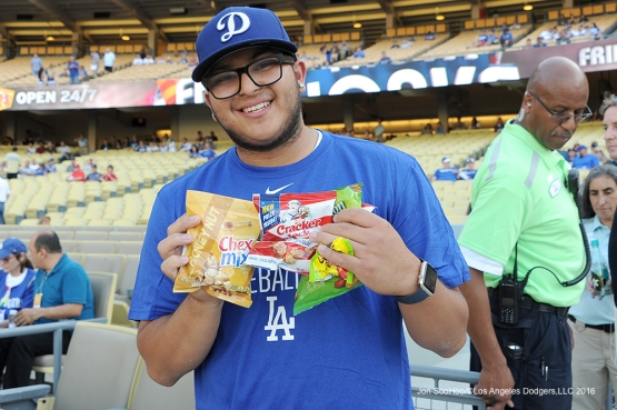 Great Los Angeles Dodgers fan poses with goodies prior to game against the Atlanta Braves Friday, June 3, 2016 at Dodger Stadium in Los Angeles,California. Photo by Jon SooHoo/© Los Angeles Dodgers,LLC 2016