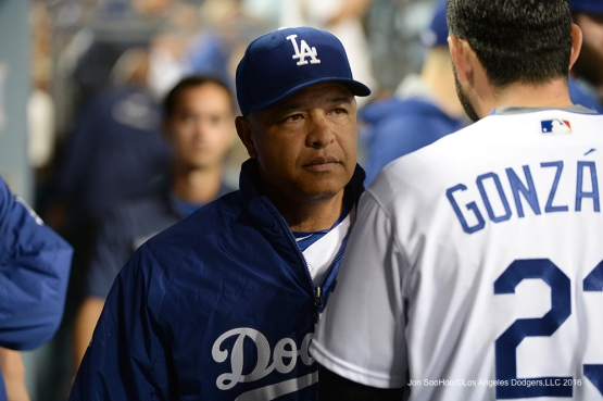 Los Angeles Dodgers Dave Roberts and Adrian Gonzalez talk during game against the Atlanta Braves Friday, June 3, 2016 at Dodger Stadium in Los Angeles,California. Photo by Jon SooHoo/© Los Angeles Dodgers,LLC 2016