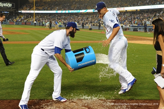 Corey Seager gets doused on by teammates Scott Van Slyke and Kike Hernandez after win against the Atlanta Braves Friday, June 3, 2016 at Dodger Stadium in Los Angeles,California. Photo by Jon SooHoo/© Los Angeles Dodgers,LLC 2016