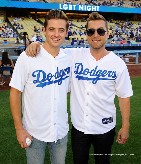 "Robbie Rogers (left) of the Los Angeles Galaxy and Lance Bass from ""NSYNC"" pose for a photo before the game between the Dodgers and Braves."