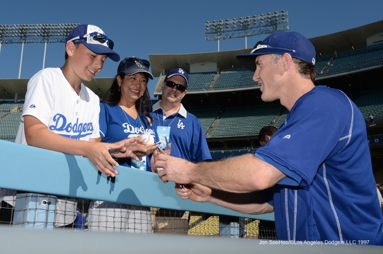 Los Angeles Dodgers Chase Utley signs for fans prior to game against the Atlanta Braves Saturday, June 4, 2016 at Dodger Stadium in Los Angeles,California. Photo by Jon SooHoo/© Los Angeles Dodgers,LLC 2016