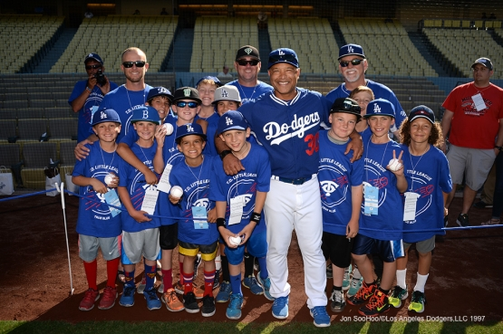 Los Angeles Dodgers Dave Roberts poses with guests prior to game against the Atlanta Braves Saturday, June 4, 2016 at Dodger Stadium in Los Angeles,California. Photo by Jon SooHoo/© Los Angeles Dodgers,LLC 2016