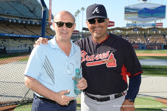 Los Angeles Dodgers Stan Kasten poses with an old friend, first base coach Eddie Perez of the Atlanta Braves Saturday, June 4, 2016 at Dodger Stadium in Los Angeles,California. Photo by Jon SooHoo/© Los Angeles Dodgers,LLC 2016