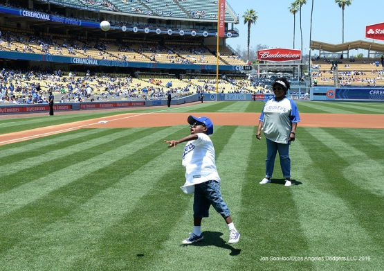 Joey Green throws out the first pitch to   A.J. Ellis prior to game against the Atlanta Braves Sunday, June 5, 2016 at Dodger Stadium in Los Angeles,California. Photo by Jon SooHoo/© Los Angeles Dodgers,LLC 2016