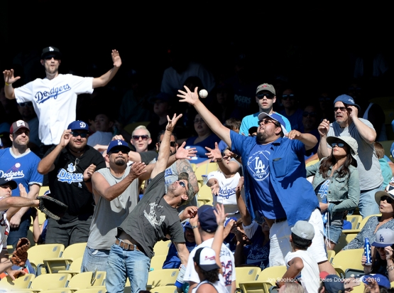Great Los Angeles Dodger fans go for foul ball during game against the Atlanta Braves Sunday, June 5, 2016 at Dodger Stadium in Los Angeles,California. Photo by Jon SooHoo/© Los Angeles Dodgers,LLC 2016