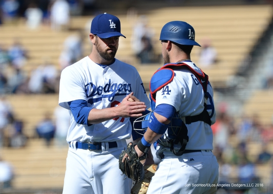 Los Angeles Dodgers Louis Coleman and Yasmani Grandal end game against the Atlanta Braves Sunday, June 5, 2016 at Dodger Stadium in Los Angeles,California. Photo by Jon SooHoo/© Los Angeles Dodgers,LLC 2016