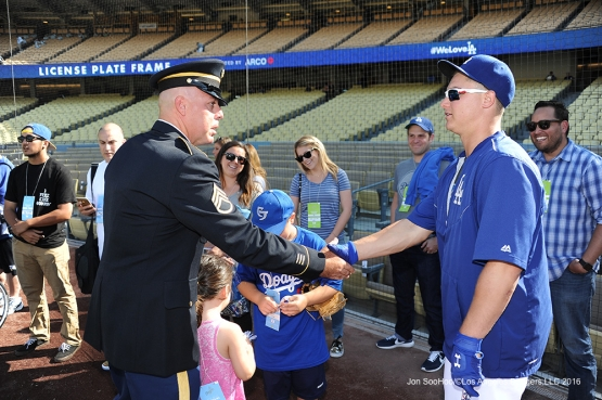 Great Los Angeles Dodger fan, Military Hero of the game, US Army Sergeant, Augie Ortman shakes hands with Joc Pederson prior to game against the Colorado Rockies Monday, June 6, 2016 at Dodger Stadium in Los Angeles,California. Photo by Jon SooHoo/© Los Angeles Dodgers,LLC 2016