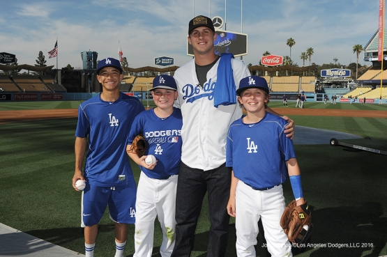 Los Angeles Rams Jared Goff poses with Dodger kids prior to game against the Colorado Rockies Monday, June 6, 2016 at Dodger Stadium in Los Angeles,California. Photo by Jon SooHoo/© Los Angeles Dodgers,LLC 2016