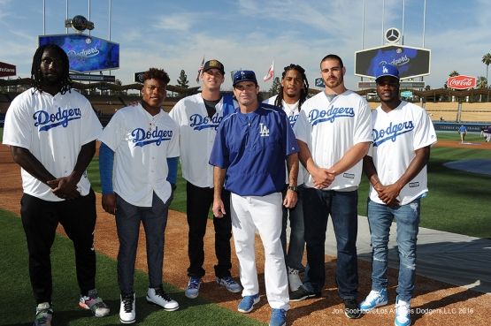 Los Angeles Rams pose with Bob Geren prior to game against the Colorado Rockies Monday, June 6, 2016 at Dodger Stadium in Los Angeles,California. Photo by Jon SooHoo/© Los Angeles Dodgers,LLC 2016