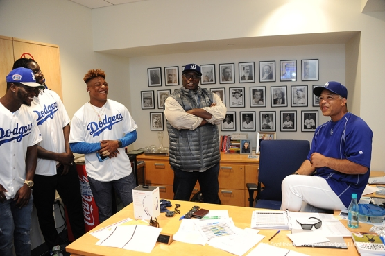 Los Angeles Rams visit with Manager Dave Roberts prior to game against the Colorado Rockies Monday, June 6, 2016 at Dodger Stadium in Los Angeles,California. Photo by Jon SooHoo/© Los Angeles Dodgers,LLC 2016