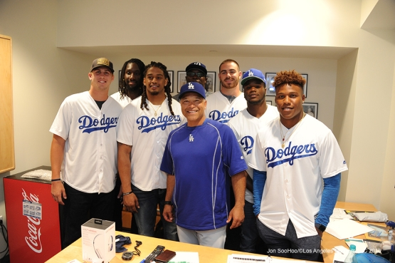 Los Angeles Rams pose with Manager Dave Roberts prior to game against the Colorado Rockies Monday, June 6, 2016 at Dodger Stadium in Los Angeles,California. Photo by Jon SooHoo/© Los Angeles Dodgers,LLC 2016