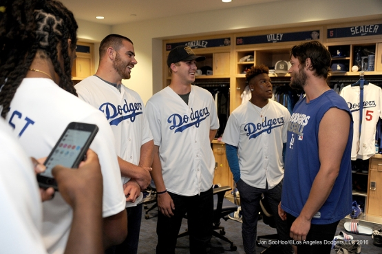 Los Angeles Rams visit with Clayton Kershaw in the clubhouse prior to game against the Colorado Rockies Monday, June 6, 2016 at Dodger Stadium in Los Angeles,California. Photo by Jon SooHoo/© Los Angeles Dodgers,LLC 2016