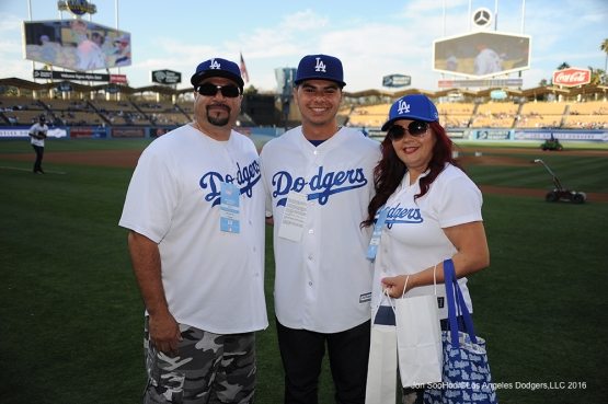 Upland High Senior, Jacob Beltran poses with his parents prior to game against the Colorado Rockies Monday, June 6, 2016 at Dodger Stadium in Los Angeles,California. Photo by Jon SooHoo/© Los Angeles Dodgers,LLC 2016