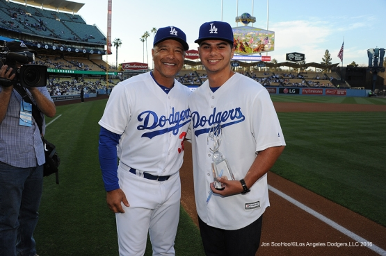 Los Angeles Dodgers Dave Roberts poses with Upland High Senior, Jacob Beltran prior to game against the Colorado Rockies Monday, June 6, 2016 at Dodger Stadium in Los Angeles,California. Photo by Jon SooHoo/© Los Angeles Dodgers,LLC 2016