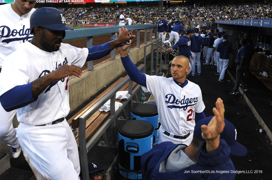 Los Angeles Dodgers Howie Kendrick high fived by Trayce Thompson prior to game against the Colorado Rockies Monday, June 6, 2016 at Dodger Stadium in Los Angeles,California. Photo by Jon SooHoo/© Los Angeles Dodgers,LLC 2016