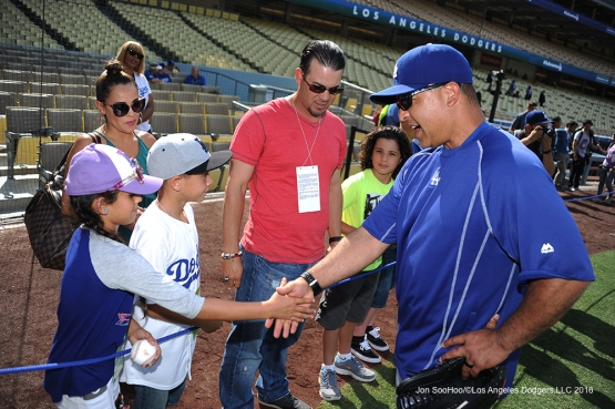 Great Los Angeles Dodger fans shake the hand of Dave Roberts prior to game against the Colorado Rockies Wednesday, June 8, 2016 at Dodger Stadium in Los Angeles,California. Photo by Jon SooHoo/© Los Angeles Dodgers,LLC 2016
