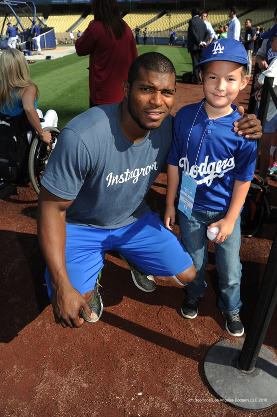Los Angeles Dodgers Yasiel Puig poses with young fan prior to game against the Colorado Rockies Wednesday, June 8, 2016 at Dodger Stadium in Los Angeles,California. Photo by Jon SooHoo/© Los Angeles Dodgers,LLC 2016